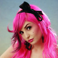Woman with pink hair color with black bow