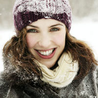 Woman in snow with dark winter hair color