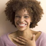 Smiling woman with brown natural curls