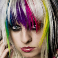 Woman with rainbow hair in a short bob
